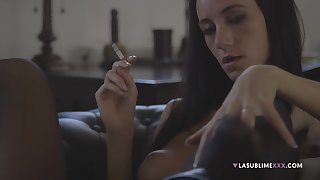 Seductive model Eveline Neill smokes and pokes her love tube